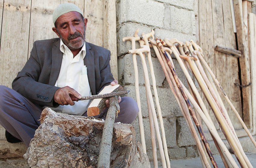 Peyal Güç continues the tradition of making walking sticks in Van, Turkey